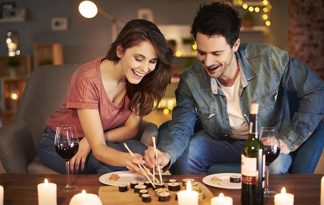 man and woman eating dinner